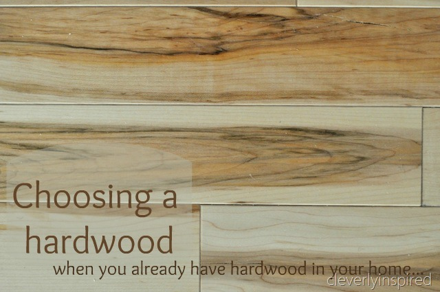 The wood we have on the first floor of our home is a beautiful walnut. It  is a prefinished floor that has a cherry stain. The floor has taken a  beating…but ... - Can You Have Two Different Hardwoods In Your Home? - Cleverly Inspired
